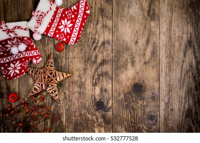 Christmas themed decorations, wooden background.
