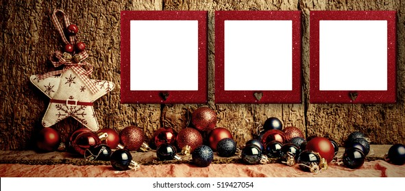 Christmas three empty photo frames, star and red and blue balls on old wooden background