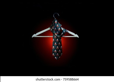 Christmas tie and coat hanger on dark background.End of the Year concept.