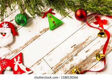 Christmas time background. Cypres branches and firtree decorations on the light wooden table
