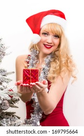 Christmas time, beautiful young girl with presents and christmas tree toys