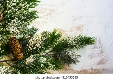 Christmas time decorations and fir tree on old white wooden table