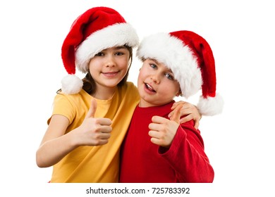 Christmas time - girl and boy with Santa Claus Hat showing OK sign