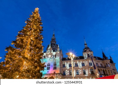 christmas time in graz,the capital of styria,austria. christmassy illuminated townhall on the main square (Hauptplatz) of the city of graz with christmas tree and the memorial for erzherzog johann