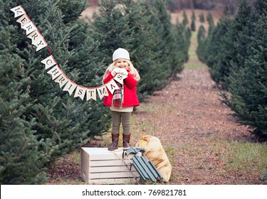 Christmas time- happy girl on tree farm