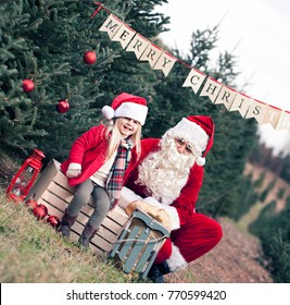 Christmas time- happy girl with santa claus