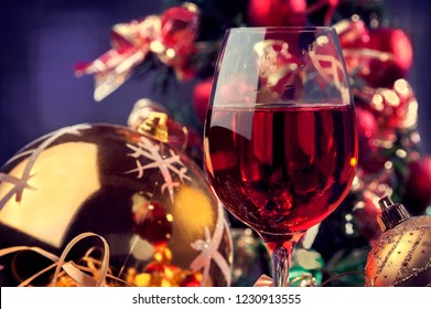 Christmas time, wine glass and Christmas decorations and ornaments