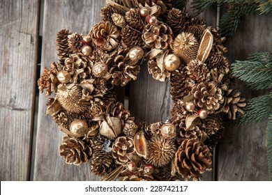 Christmas. Christmas time. Christmas wreath. Pine cones wreath. Evergreen. Wood. Wooden background.