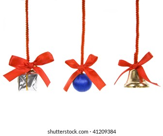 Christmas tinsel with red bows  on white background