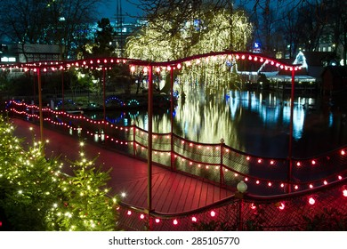 Christmas at the Tivoli in Copenhagen at night. Illuminations on the lake