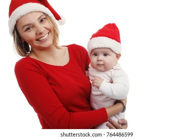 Christmas together-happy mother and girl in Santa hat. In Studio on white background isolated