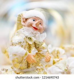 Christmas toy elf in gold.