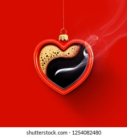Christmas toy is made from a fragrant cup of coffee. Christmas toy. Holiday concept. Cup in the shape of a heart on a red background for your design. Advertising coffee.