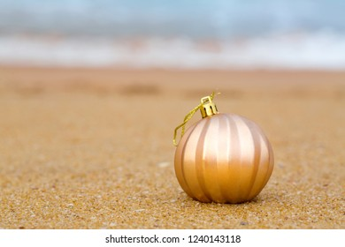 Christmas toy on a sandy beach by the ocean