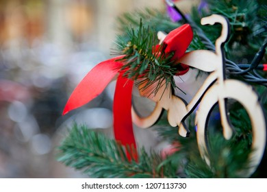 Christmas toy on the Christmas tree in the form of a Bicycle