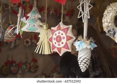 Christmas toys at the fair. Bells, pendants, baubles