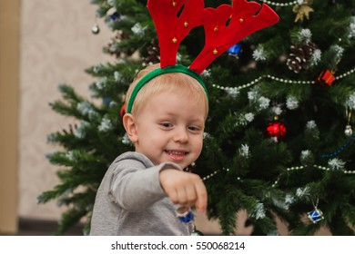 Christmas toys in hand boy