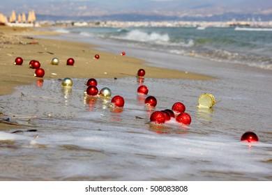 Christmas toys on the beach. New year on the beach, Christmas beach.