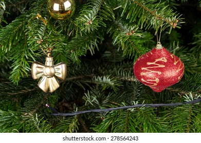 Christmas toys on pine tree branch. Macro. Can be used as a whole background.
