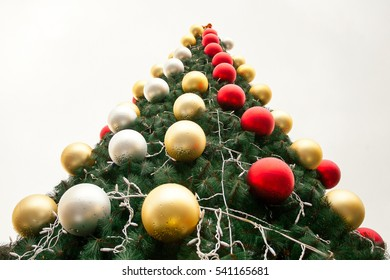 Christmas toys are on the Christmas tree. New year on white background, it's glass ball and tree branches