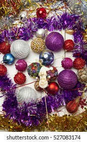 Christmas toys, purple on white wooden background