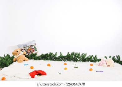 christmas toys and tangerines on snowy white carpet