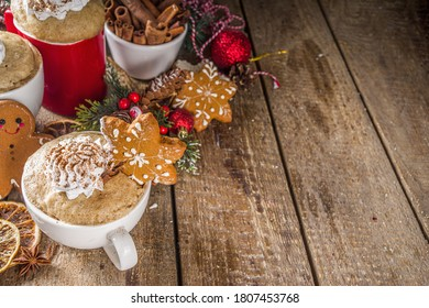Christmas traditional gingerbread in mug. Simple and fast recipe idea for Christmas breakfast, mugcake in microwave with traditional winter spices, on xmas decorated wooden background copy space