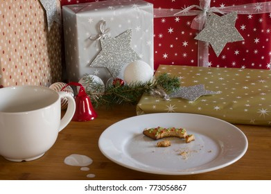 Christmas traditions. Gingerbread cookies on xmas presents background with marshmallows and decoration.