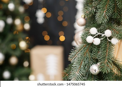 Christmas tree background. New Year composition with spruce, balls and lights