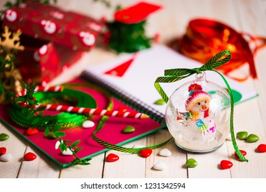 Christmas tree ball with Christmas accessories on rustic white woody background. Copy space
