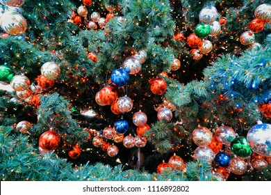 Christmas Tree with Balls on Christmas Market in Winter Berlin, Germany.