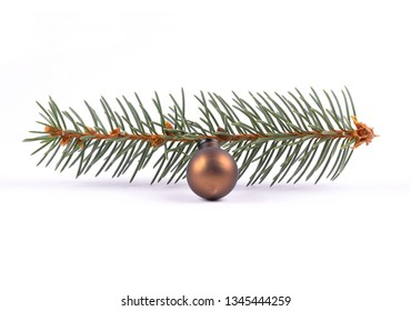 Christmas tree baubleand twig on white