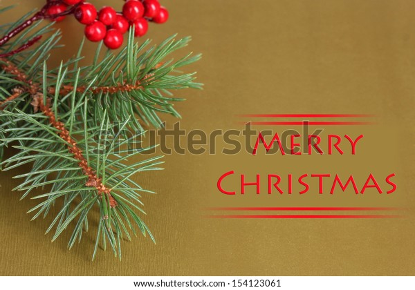 Christmas tree with beautiful New Year's berries on table