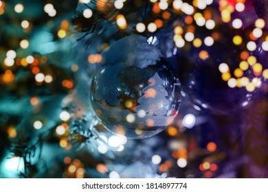 christmas tree branch with christmas balls and lights