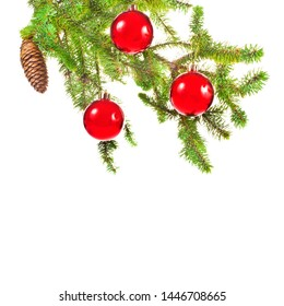 Christmas tree branch with a bump and red Christmas balls isolated on white background
