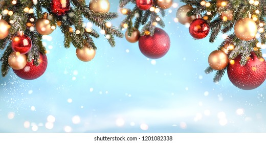 christmas tree branch decoration with red and golden christmas balls on blurred background - Shutterstock ID 1201082338