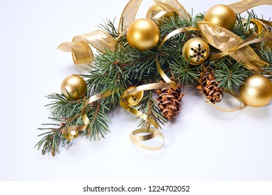 Christmas tree branch with gold balls and ribbons