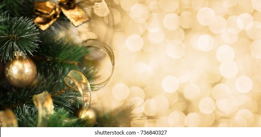 Christmas tree branch with golden background