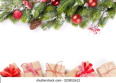 Christmas tree branch with snow and gift boxes. Isolated on white background with copy space