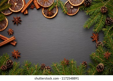 Christmas tree branches on black background as a border or template for christmas card