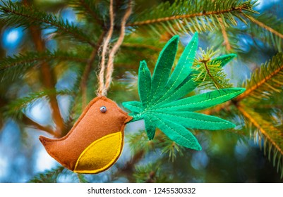 Christmas tree. cannabis leaf in the bird's beak. Medical marijuana new year product recreation