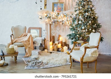 Christmas tree, chairs and vintage decorations near fireplace