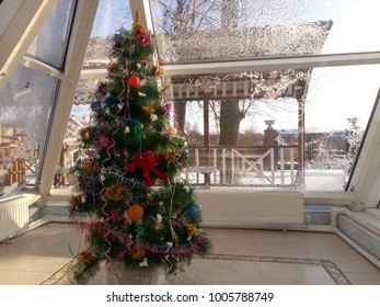 Christmas tree, closeup, copy space on window. Winter holiday design and decorations background