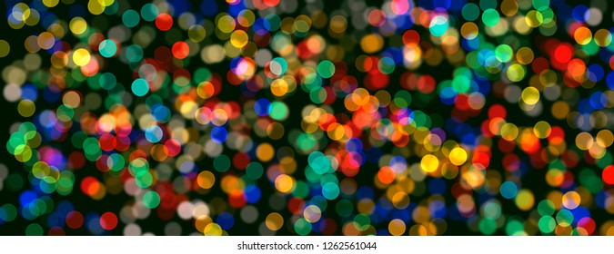 Christmas tree with colorful lights bokeh background