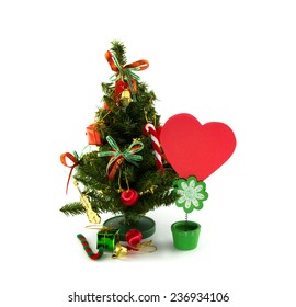 Christmas tree with colorful ornaments and cards isolated on white