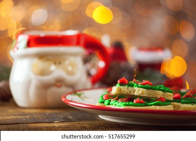 Christmas Tree Cookies On Holiday Plate By Warm Glowing Light Fire Background.