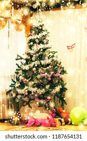 Christmas tree decorated with balls and garlands in a cozy home interior, Christmas gifts and falling golden snowflakes
