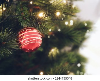 Christmas tree decorated with beautiful ornaments,celebrate the christmas season with vintage style.garland background and xmas wallpaper.