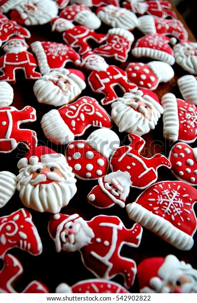 Christmas tree decorated cookies , red and white color