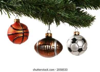 A Christmas tree decorated with a football; soccer ball, and basketball ornaments